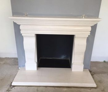Completed installation of Portuguese Limestone Fireplace Surround in Binsted
