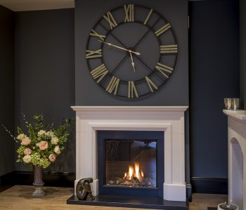 picture of a limestone fireplace