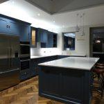 carrara light classic quartz worktops on grey blue kitchen island