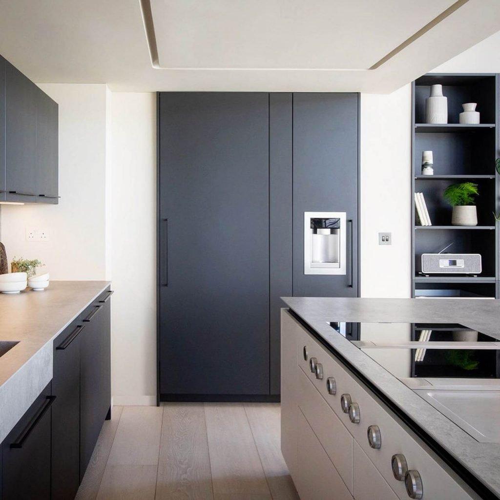 Kreta Dekton Kitchen Worktop Light Grey, dark and white cabinets and grey fridge