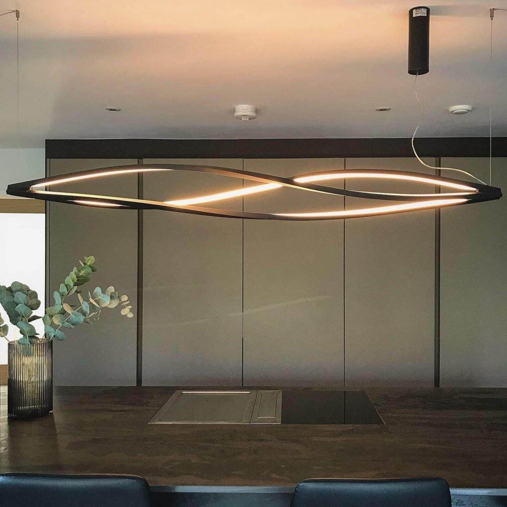 Kitchen island with a Radium Dekton Kitchen Worktop with a modern hob