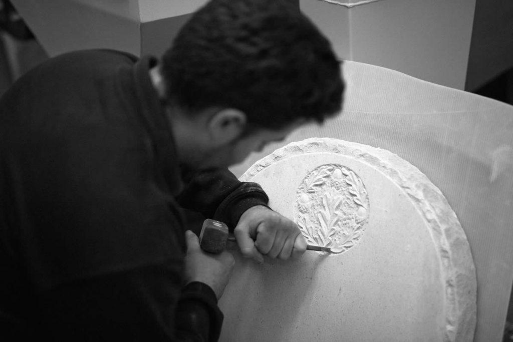 county stone master stonemason handcrafting a graveyard stone
