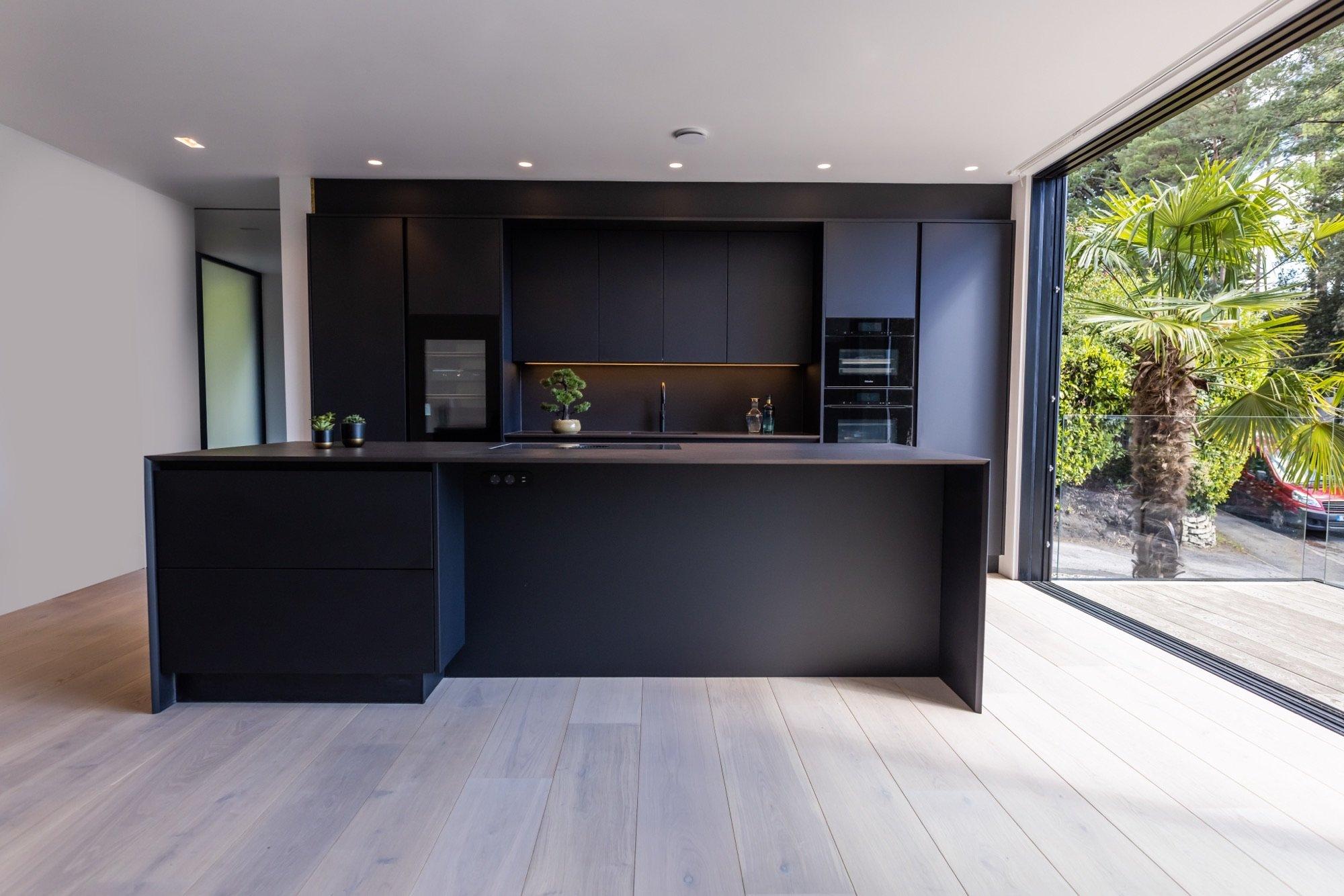 Dekton Sirius Kitchen Worktop with Black Grey Cabinets