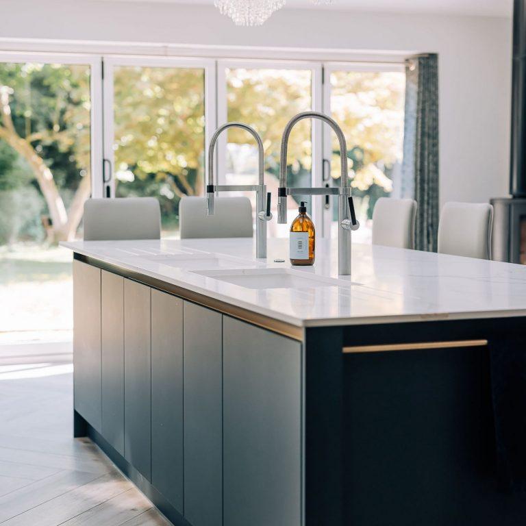 Classic Quartz Calacatta Grigio worktop on dark grey kitchen island