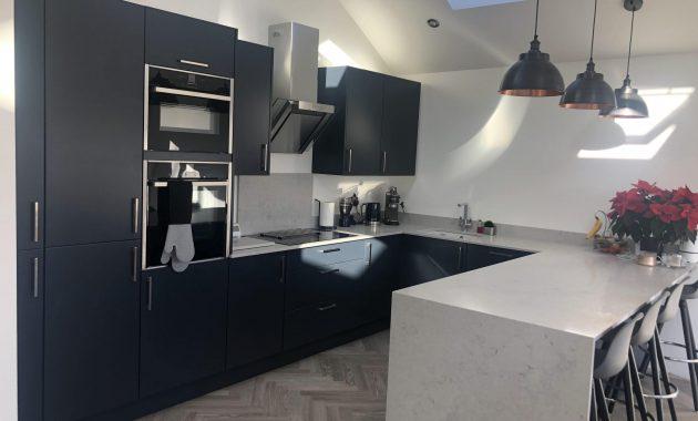 Noble Grey Caesarstone Quartz Kitchen Worktop with dark grey cabinets-min